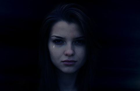 Crying girl in darkness