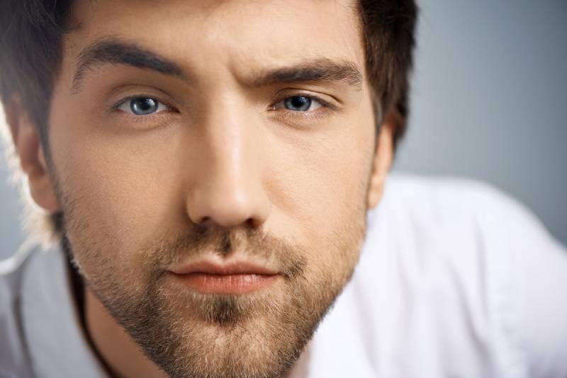 close up of man raising eyebrows