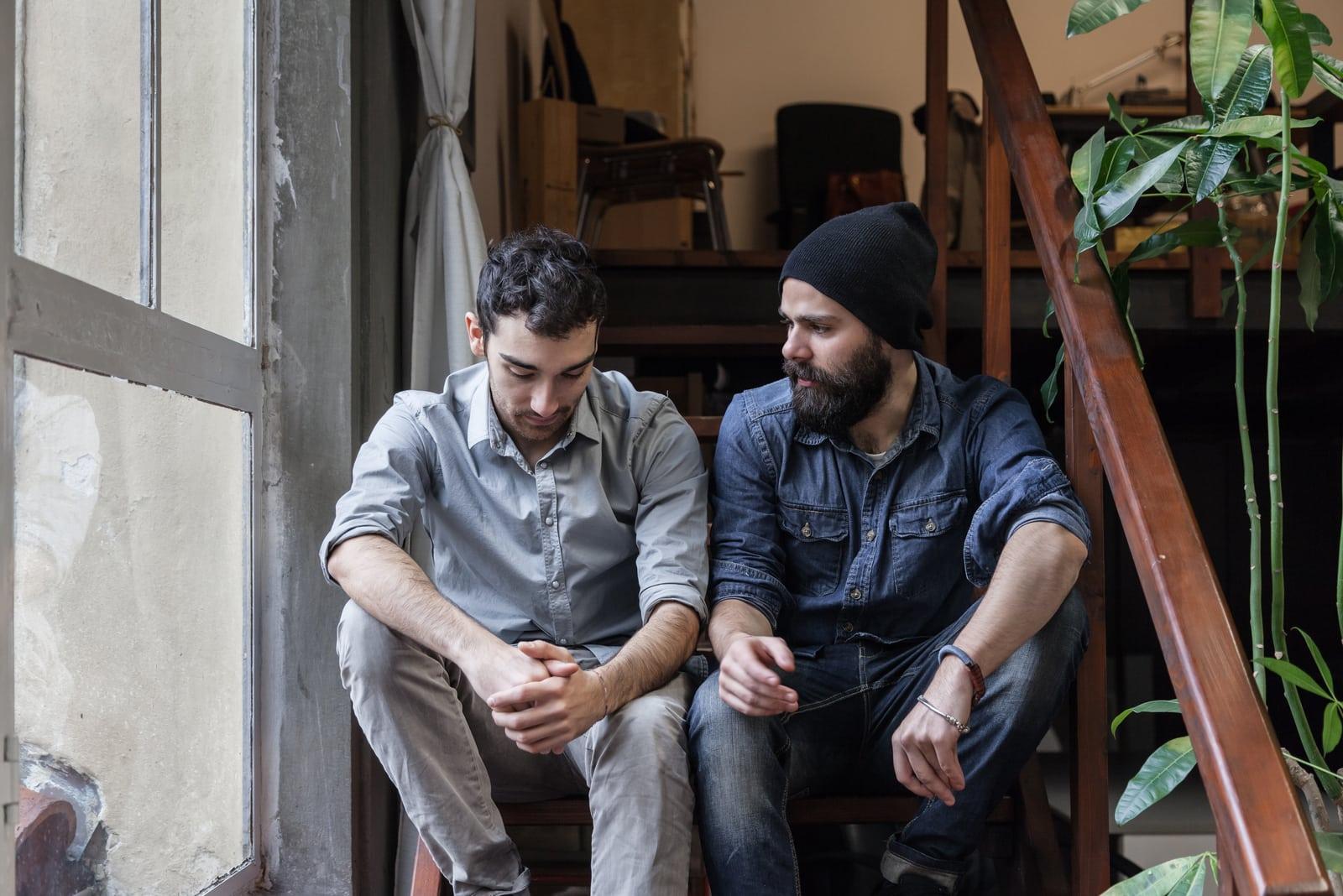 a man talking to a friend