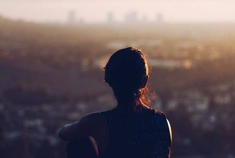 Girl on a viewpoint looking at the city
