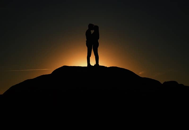 Silhouette of a couple kissing