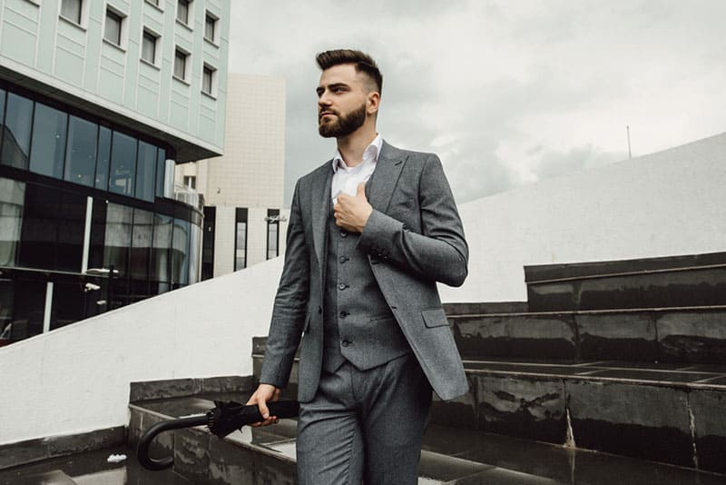 handsome man in suite walking