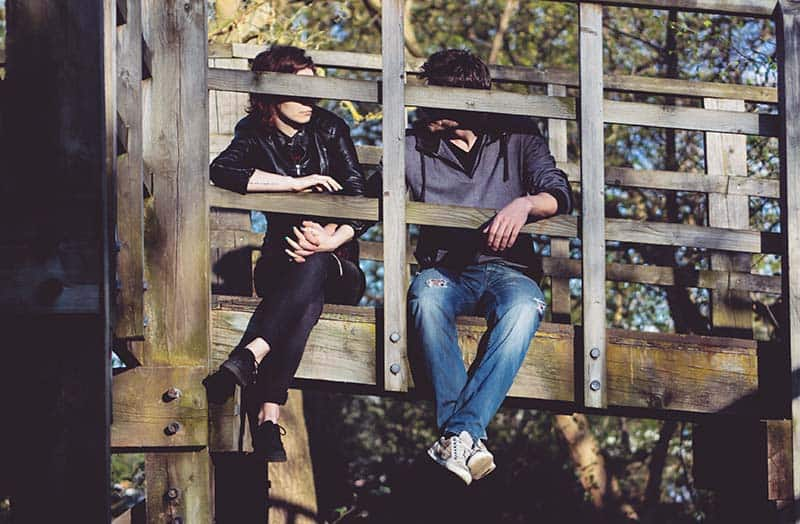 Couple sitting in nature