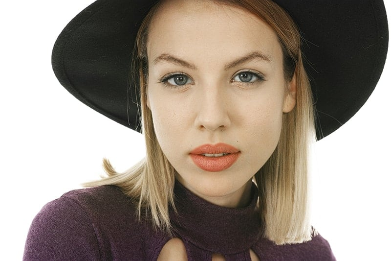 Young blond woman with a hat on