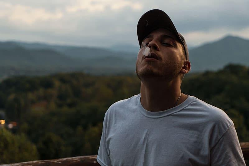 young man smoking outdoor