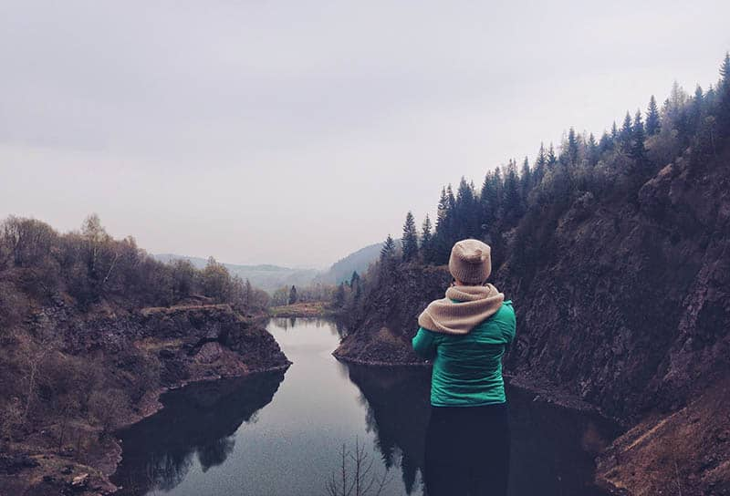 Woman taking photo of the landscape