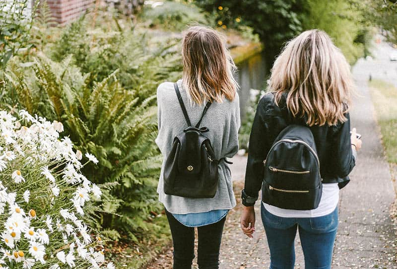 Two girls walking on the street