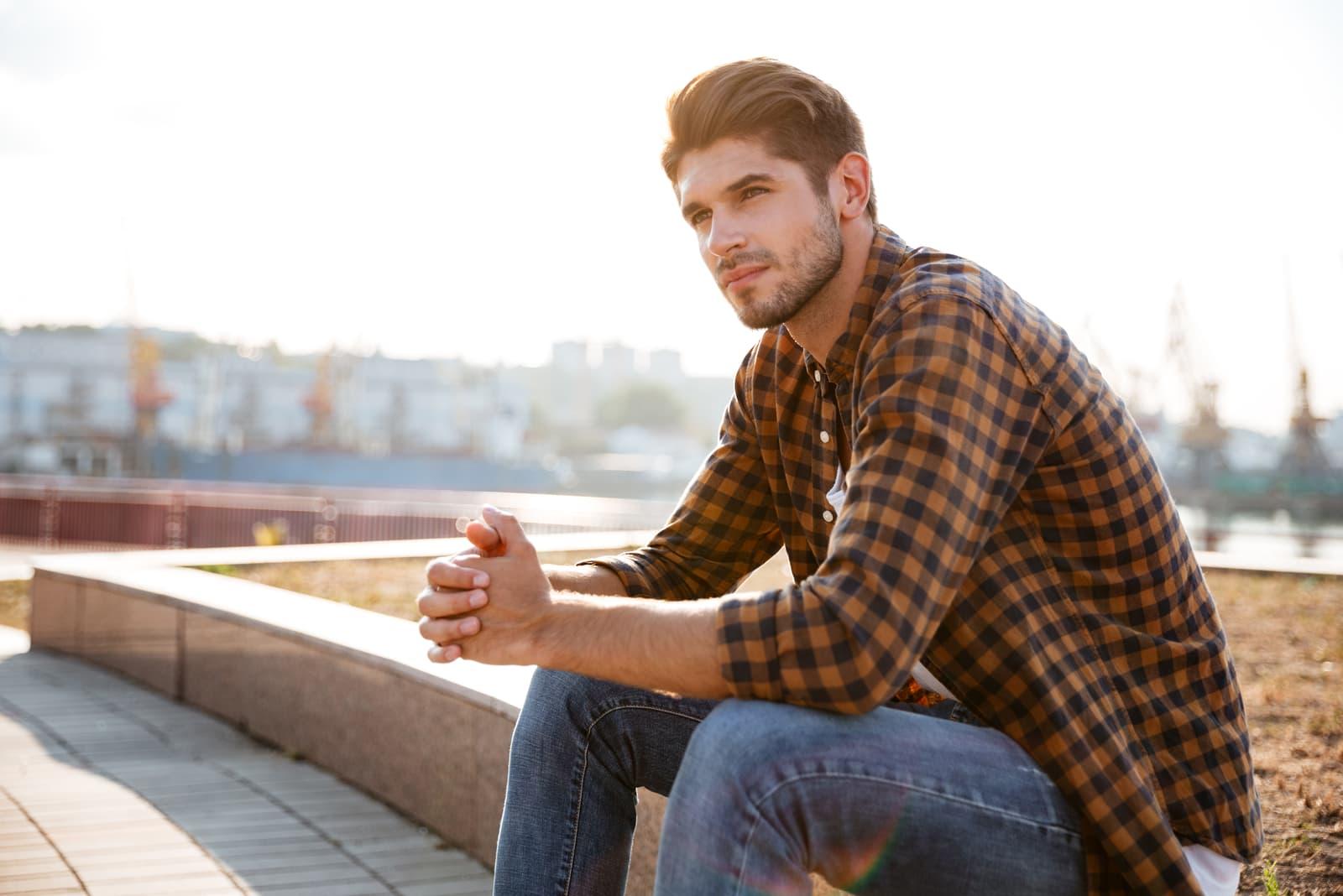 handsome man sitting outside