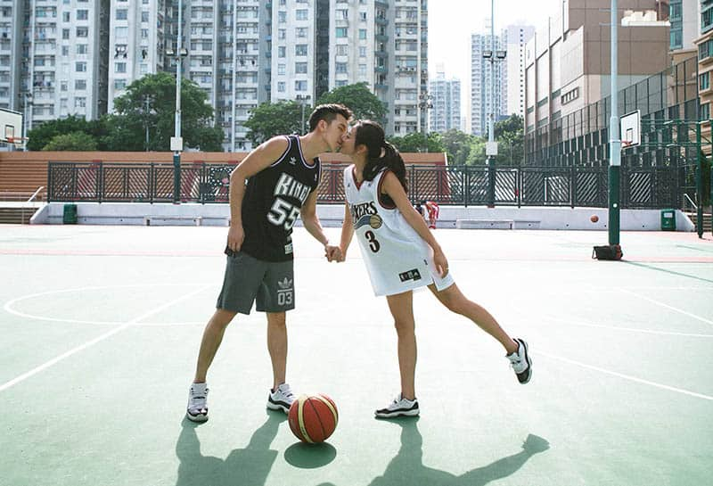 Couple kissing on basketball court