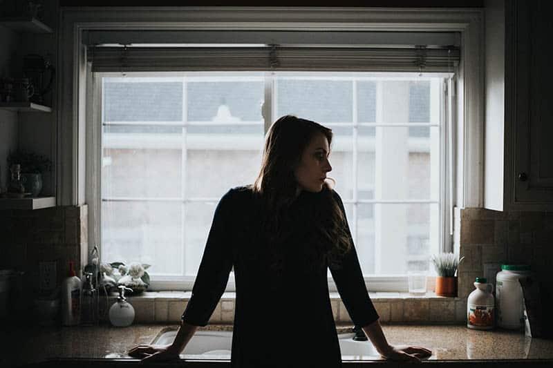 Sad woman in kitchen