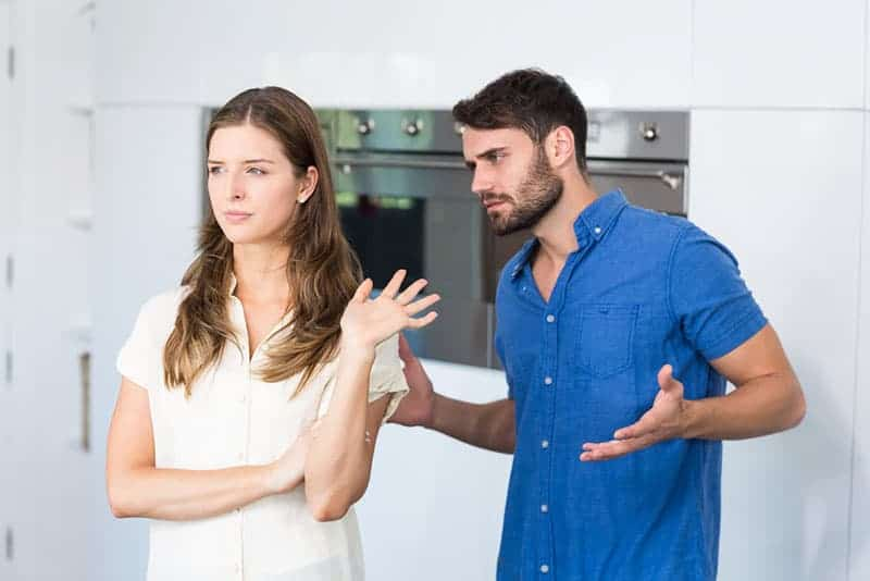 man trying talk to upset woman