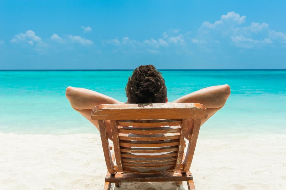 a man lying on the beach