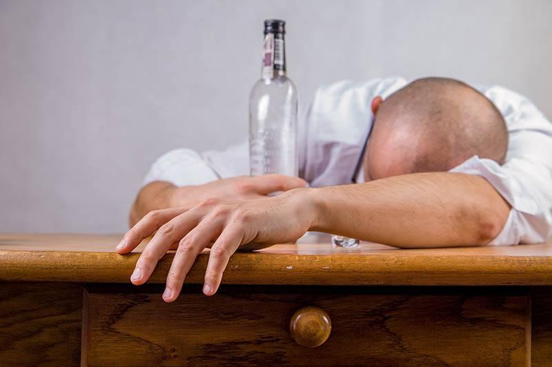drunk man sleeping on table