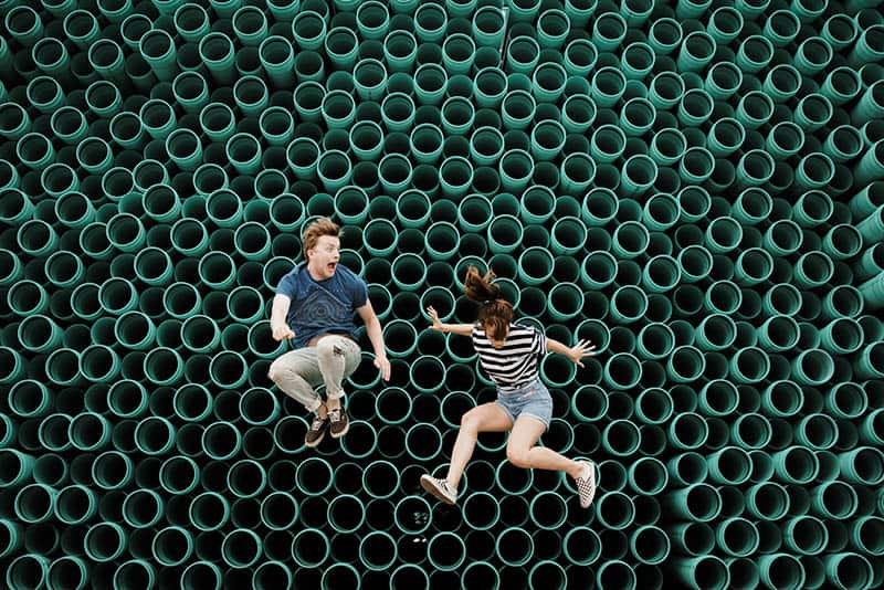 Man and woman jumping and having fun