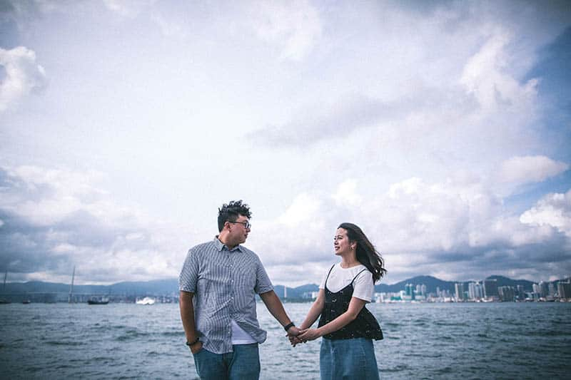 Couple holding hands by the ocean
