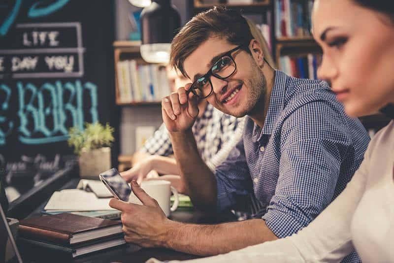 man wearing eyeglasses and looking staring at woman