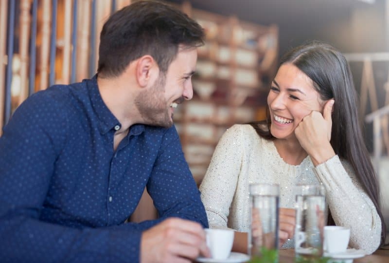 smiling couple enjoying in coffee eat cafe