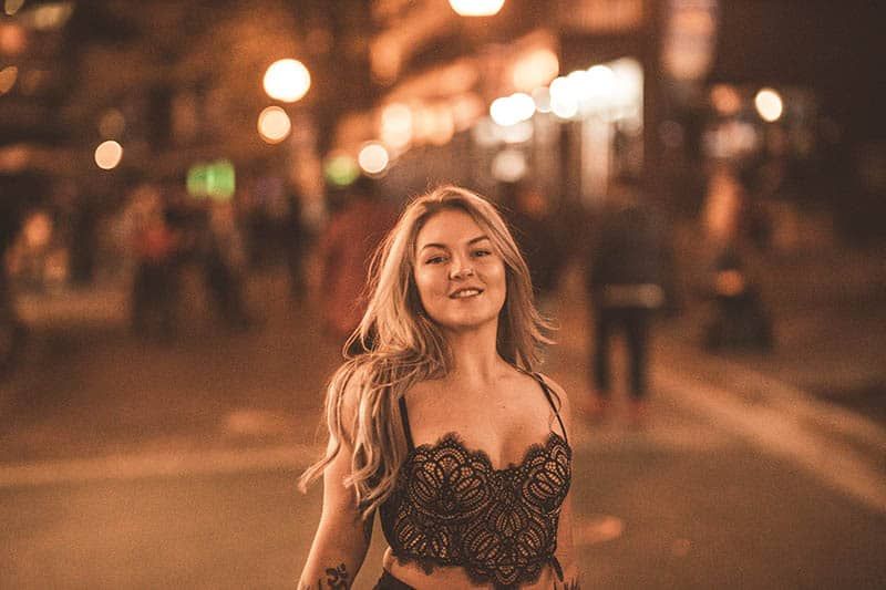 woman wearing top lace outside during night