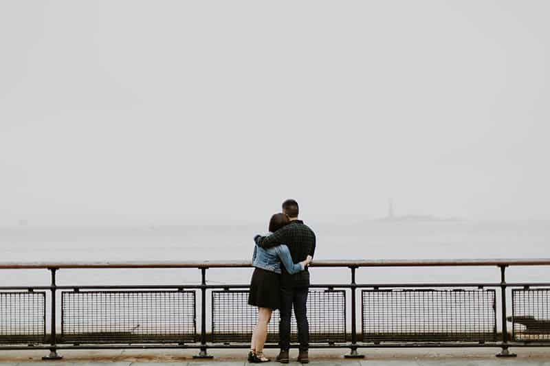Couple hugging by the ocean