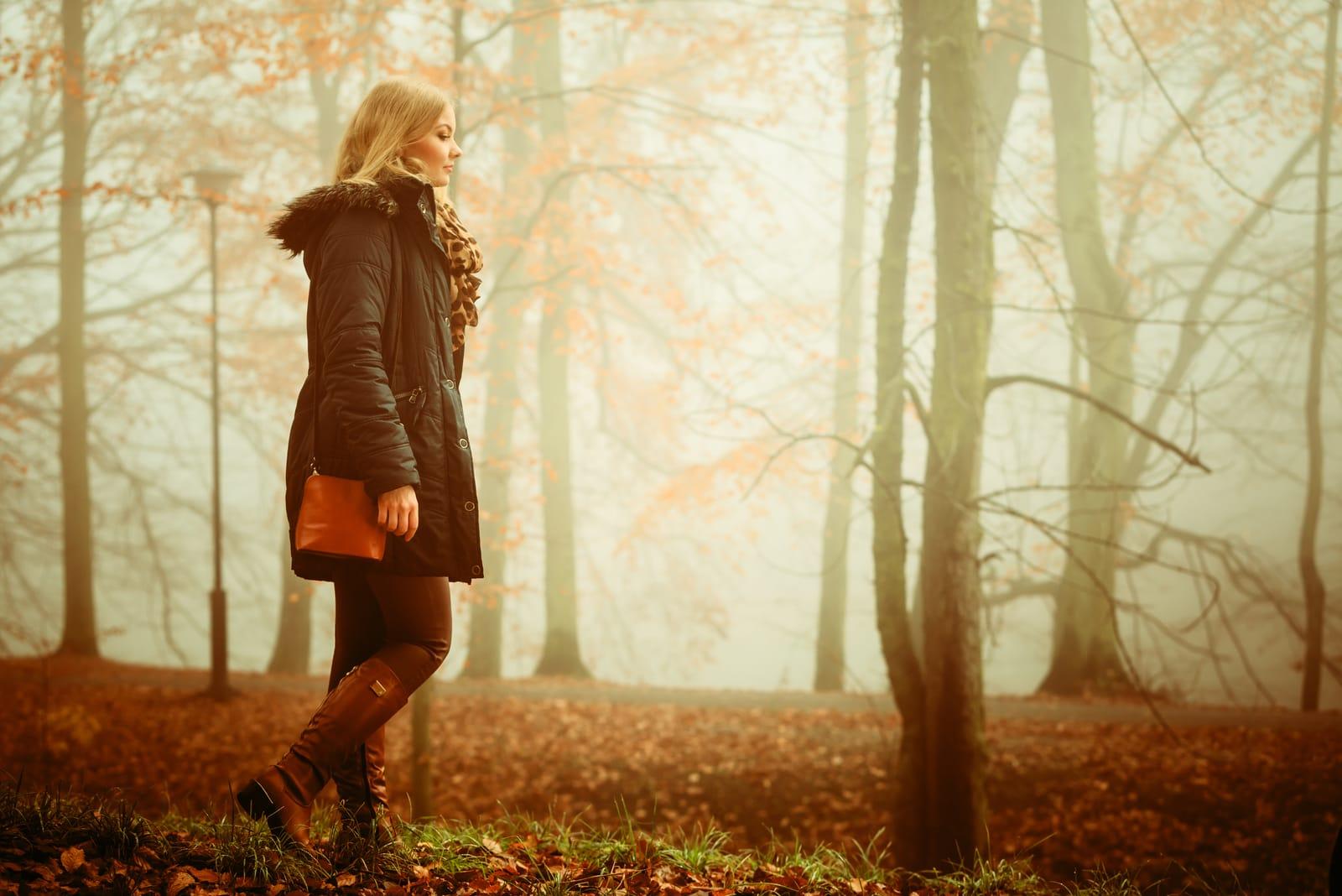 lonely woman walking in park