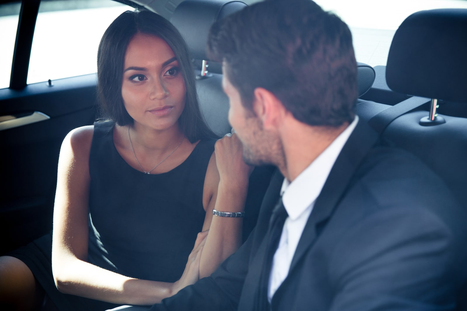 couple sitting in the car talking