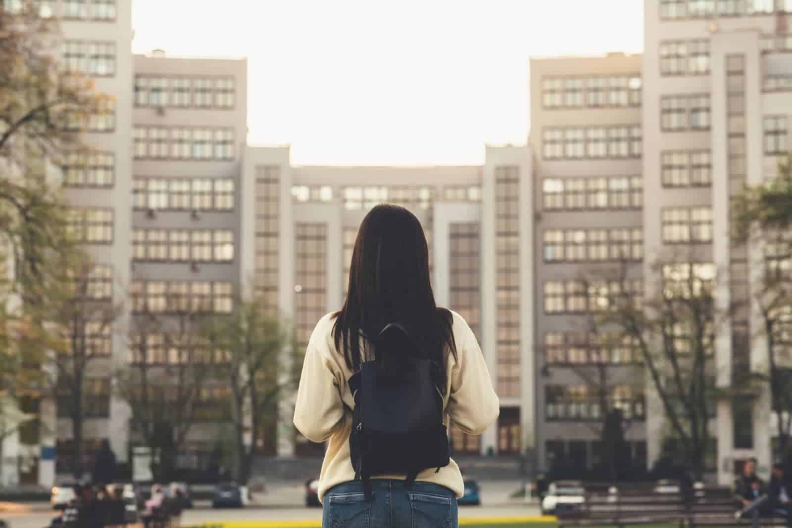 girl with long hair wearing backpack