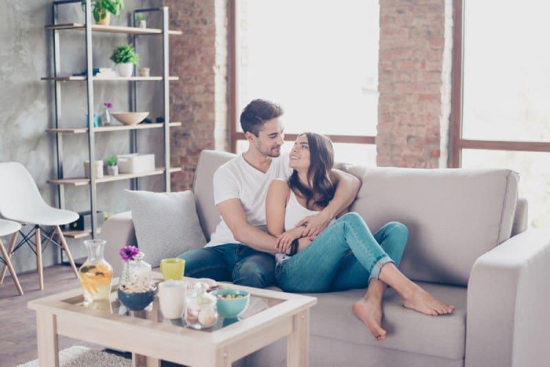 happy couple hugging in living room