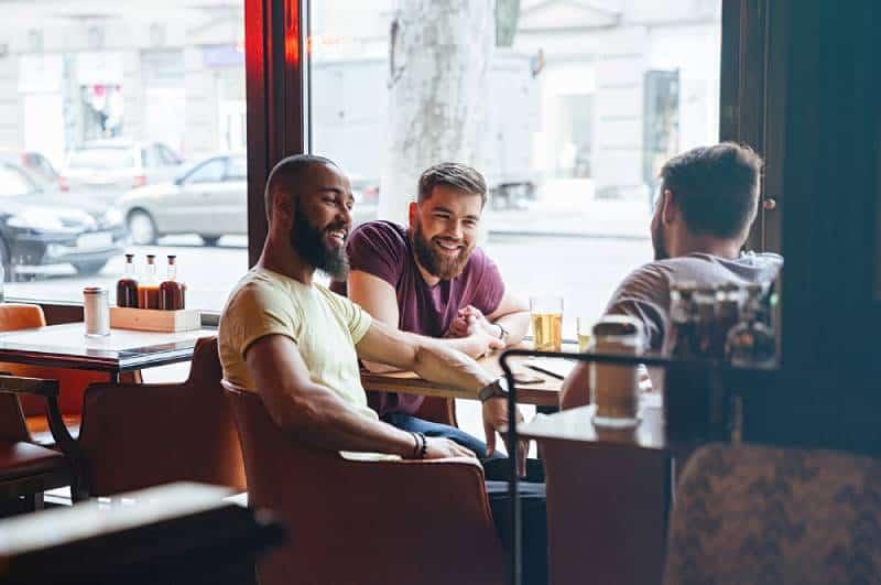 male friends talking in pub