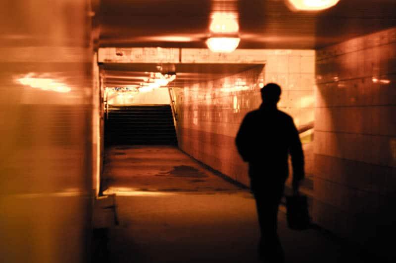 man walking through the subway