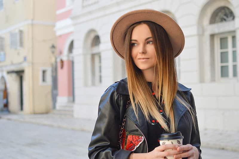 Girl walking the street slightly smiling