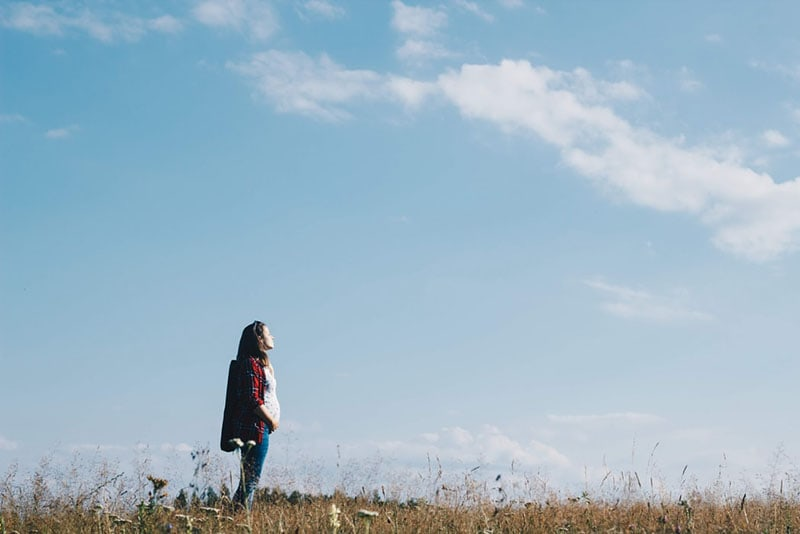pregnant woman standing in the field