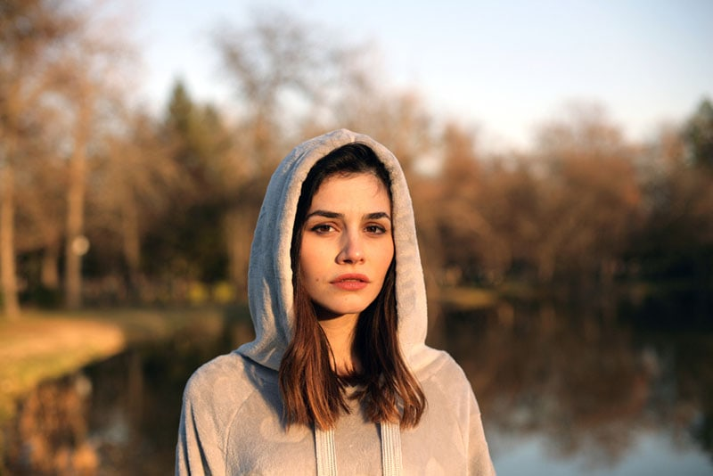 serious woman wearing hoodie posing