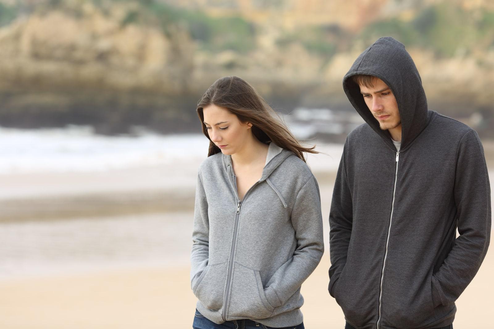 upset couple walking outdoor