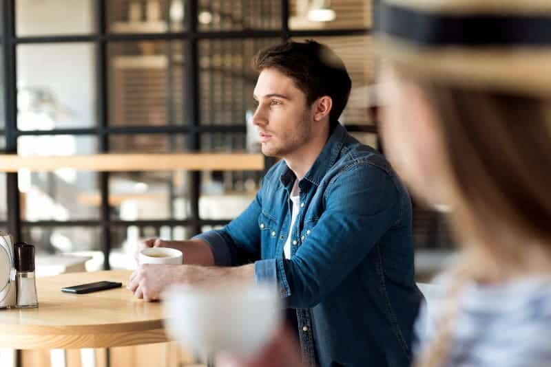 Worried guy in cafe