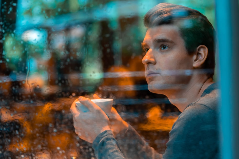 a man in a cafe is sitting by the window