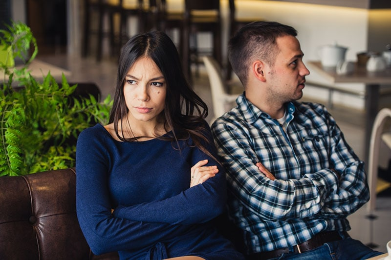 angry woman looking away from boyfriend