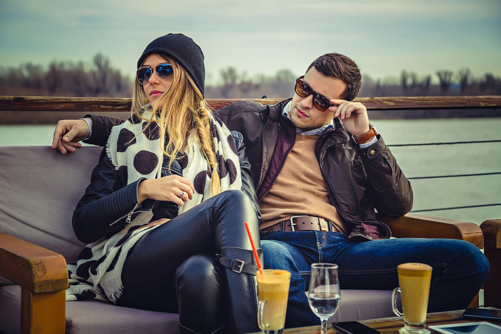 man and woman sitting drinking coffee