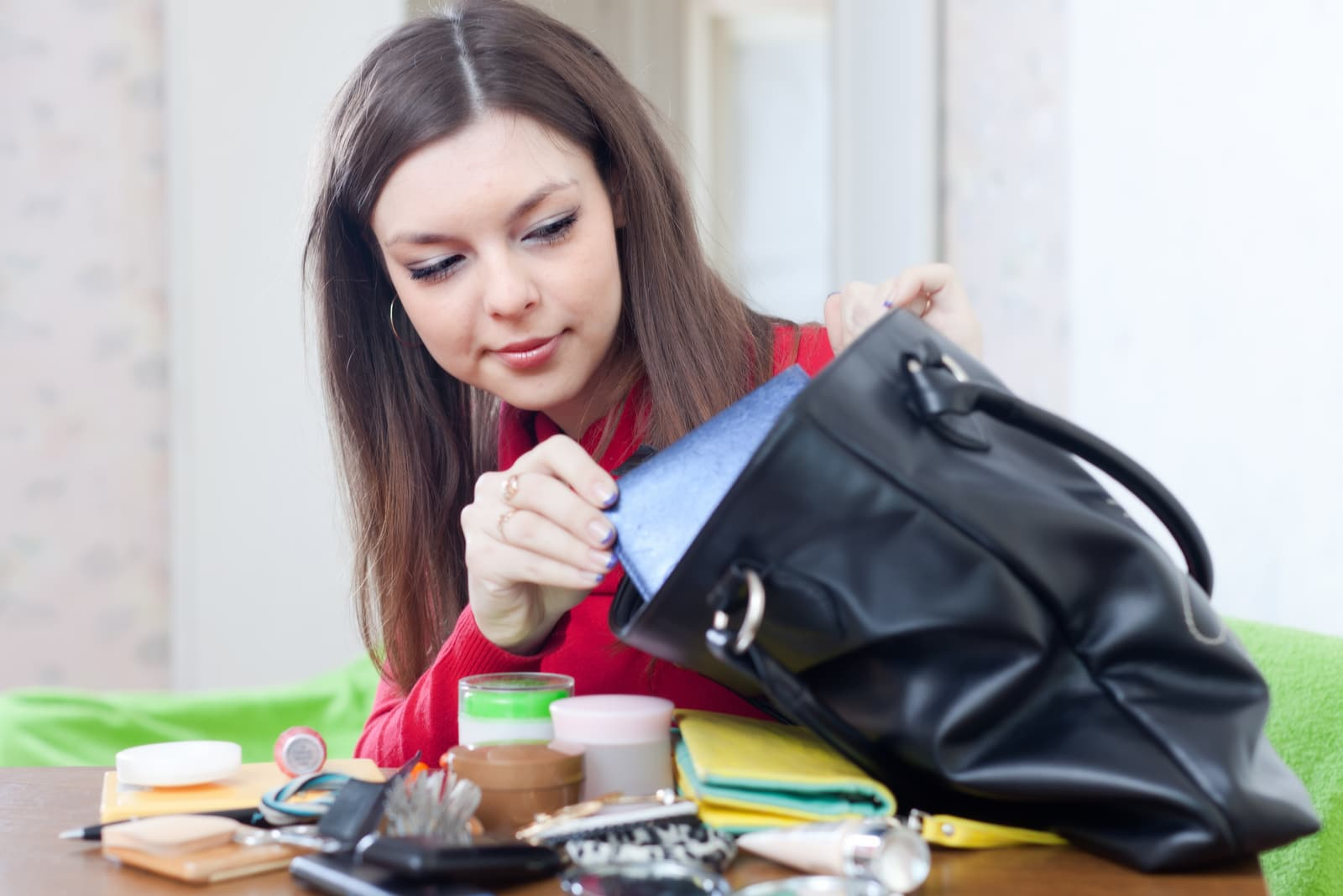 a woman is looking for something in her purse