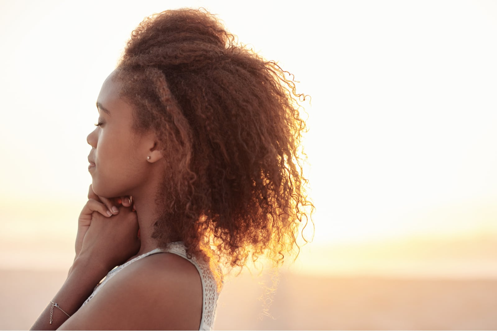 a young black woman enjoys the sunset