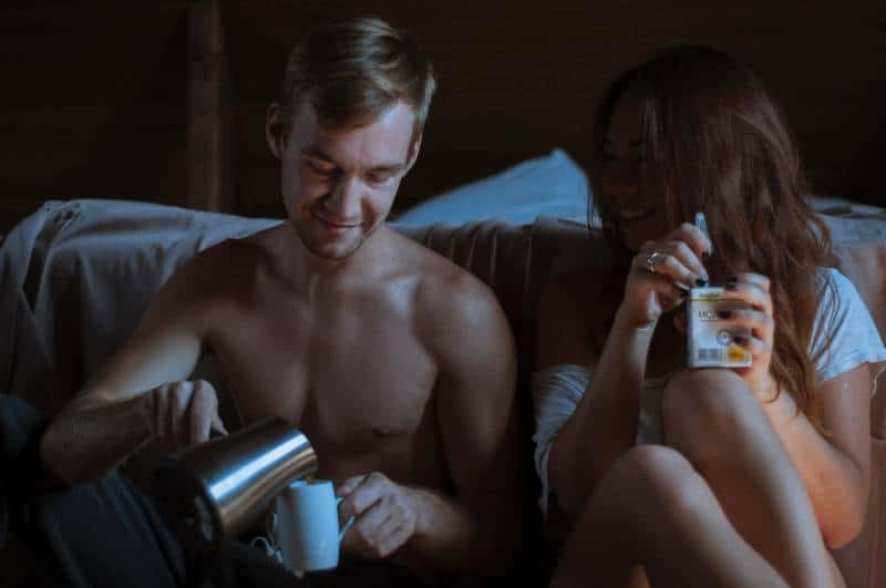 couple drinking coffee at night