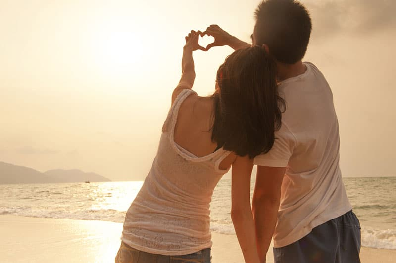 couple in love standing on the beach