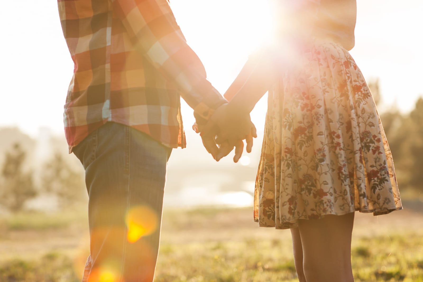 couple in nature holding hands
