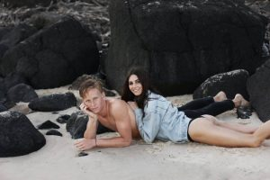 couple laying on the beach