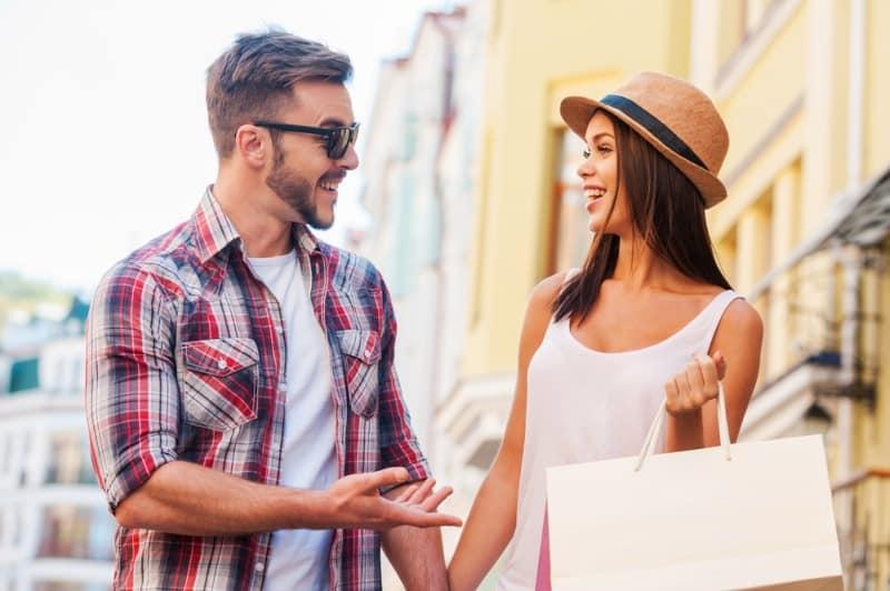 couple talking on a street