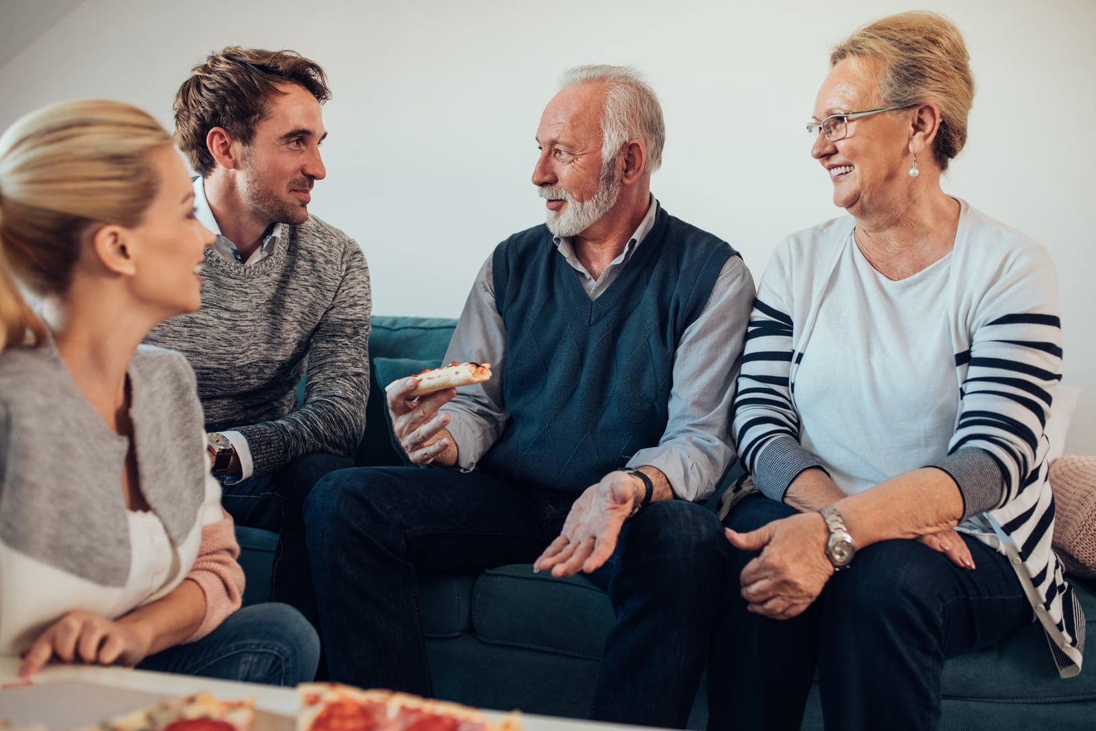 couple talking with their parents
