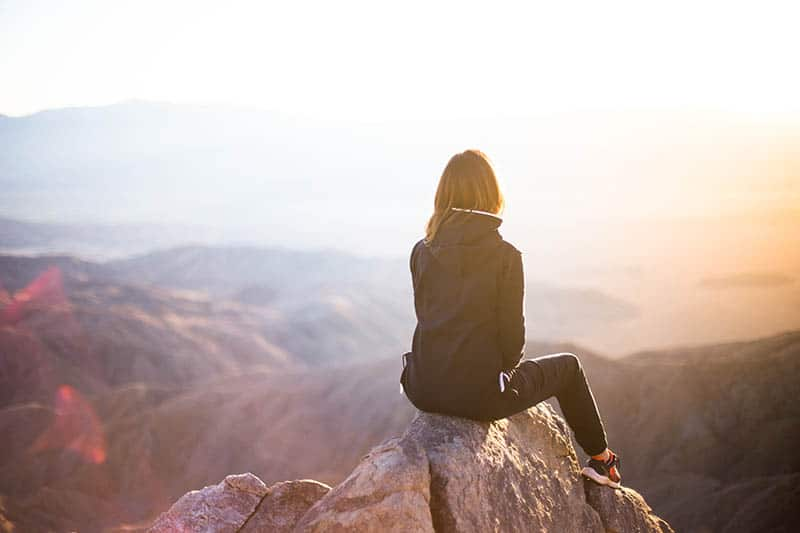 Woman observing landscape at a viewpoint