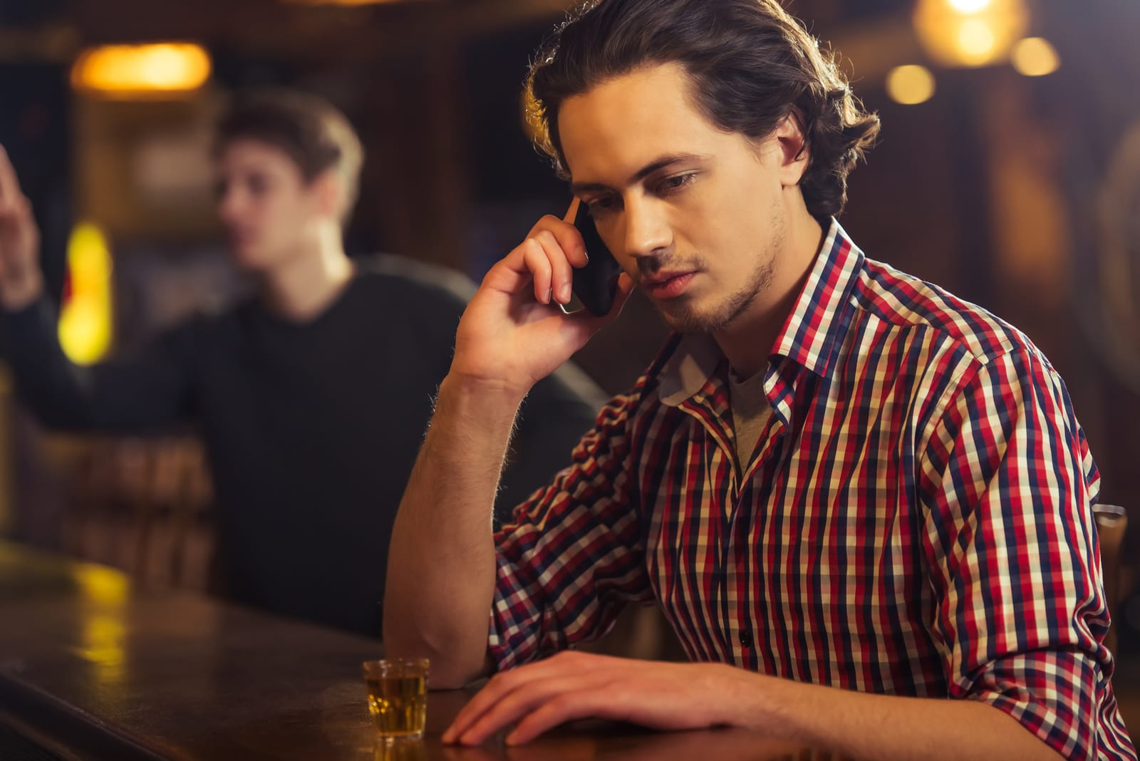 drunk man in the bar talking on phone