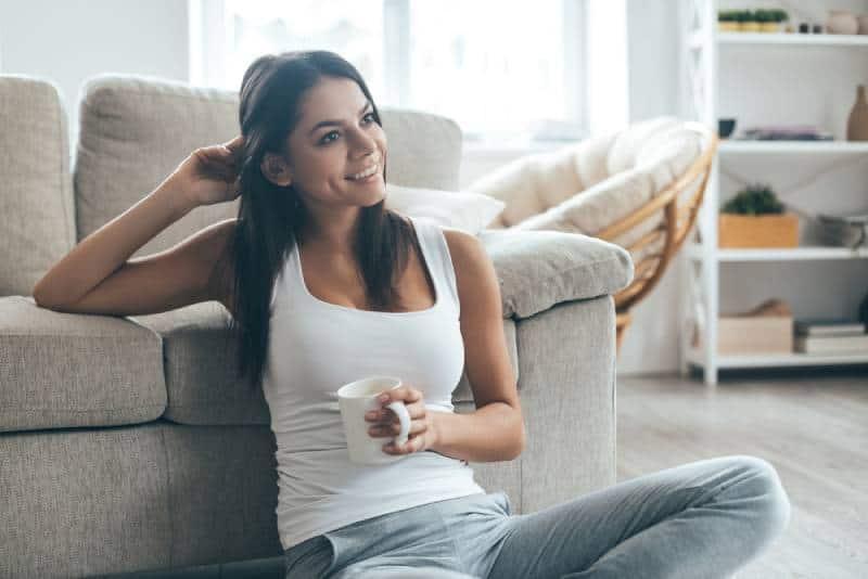 girl enjoying at home while sitting on floor