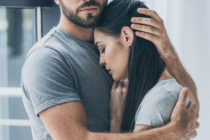 handsome man hugging a woman