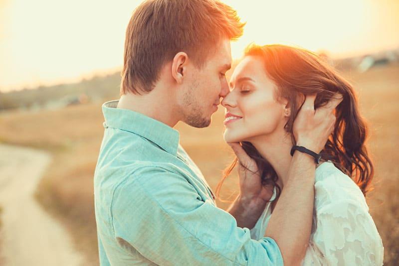 happy man holding woman hair